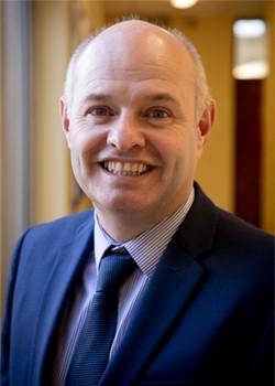 Adrian Delaney – Principal
